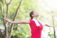 Asian woman enjoying nature after exercising Stock Photo