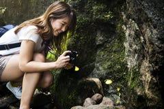 Asian woman enjoying an outdoor trip royalty free stock images