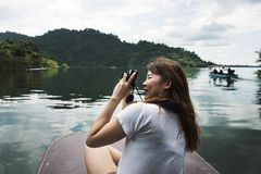 Asian woman enjoying an outdoor trip royalty free stock photography
