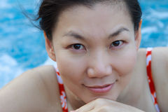 Asian woman enjoying and relaxing in the pool. Royalty Free Stock Photography