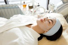 Asian Woman Enjoying SPA Treatment royalty free stock images