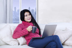 Asian woman enjoying time in the apartment Royalty Free Stock Images