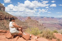 Woman sitting on the Bright Angel Trail Stock Images