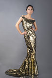 Asian woman in evening dress Stock Photo
