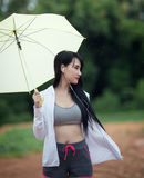 Asian Woman exercise, listening to music with headphones. Royalty Free Stock Image