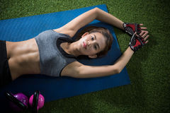 Asian woman exercise and workout in fitness gym. And relax after situp Stock Image