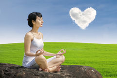 Asian woman exercise yoga under love cloud Stock Image