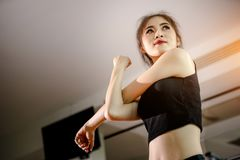 Asian woman exercising in the gym. Young woman workout in fitness for her healthy and office girl lifestyle Stock Photo