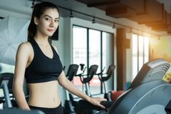 Asian woman exercising in the gym, Young woman workout in fitness royalty free stock photography