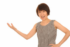 Asian woman explaining. An asian woman gesturing and explaining things isolated on white Royalty Free Stock Photography