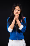 Asian woman expressing emotions in studio Stock Image