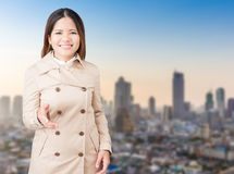 Asian woman extending hand to shake Royalty Free Stock Photo