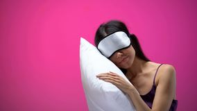 Asian woman in eye mask sleeping on pillow, resting after hard day, silence. Stock photo stock photography