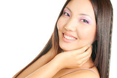 Asian woman face. Beautiful asian girl touching her face isolated on white background Royalty Free Stock Image