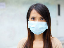 Asian woman with face mask Royalty Free Stock Photo