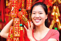 Asian woman with fake crakers Royalty Free Stock Photography