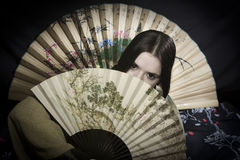Asian woman with fan Royalty Free Stock Photography