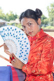 Asian woman with fan Stock Images