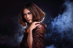 Asian Woman Fashion Make Up brunette hair, studio lighting black Stock Photos