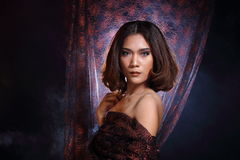 Asian Woman Fashion Make Up brunette hair, studio lighting black Stock Photography