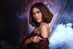 Asian Woman Fashion Make Up brunette hair, studio lighting black Royalty Free Stock Images