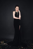 Asian woman with fashion makeup in luxury black dress. Royalty Free Stock Image