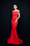 Asian woman with fashion makeup in luxury red dress. Stock Image