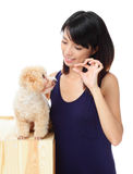 Asian woman feeding poodle dog. Asian woman with poodle dog isolated on white Royalty Free Stock Images