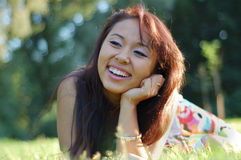 Asian woman in a field Stock Image