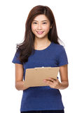 Asian woman with file board Royalty Free Stock Photos