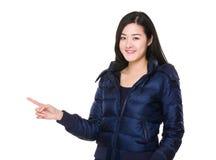 Asian woman with finger point aisde stock photos