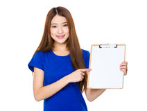 Asian woman finger point to blank page of clipboard. Isolated on white background Royalty Free Stock Photos