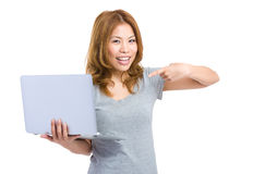 Asian woman finger point to laptop Royalty Free Stock Photos