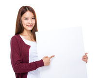 Asian woman finger point to placard Royalty Free Stock Image