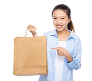 Asian woman finger point to shopping bag Stock Images