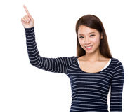 Asian woman finger point up Stock Images