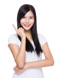 Asian woman with finger point up Royalty Free Stock Photography