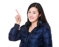 Asian woman with finger point up Stock Images