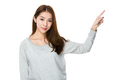 Asian woman with finger point up royalty free stock photo
