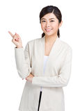 Asian woman finger pointing up Royalty Free Stock Photo
