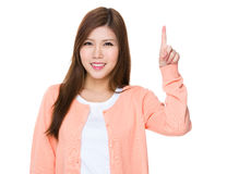 Asian woman with finger pointing upwards Stock Image