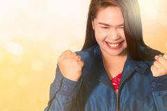 Asian woman with fists raised up gesture,  successful, celebrating victory,achievement and winning royalty free stock photos