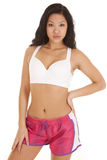 Asian woman fitness pink shorts serious Stock Photo