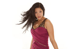 Asian woman flip hair serious. A beautiful woman showing her sensual side and flipping her hair while wearing a beautiful dress Stock Photo