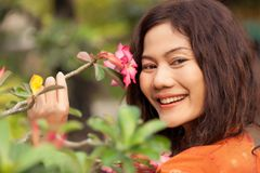 Asian woman and  flower Stock Image