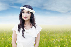 Asian woman with flower crown at field stock photography