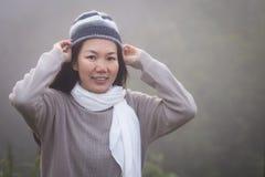 Asian woman in fog Stock Photo