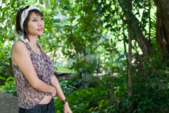 Asian woman in forest. A beautiful asian woman in green forest Royalty Free Stock Images