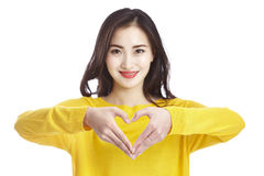 Asian woman forming heart shape with hands royalty free stock images