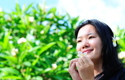 Asian woman and frangipani tree Royalty Free Stock Photos